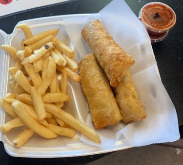 Steak and Cheese Egg Rolls w. Fries w. a side of mambo
